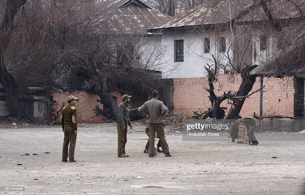 Policemen play cricket during a strike called by separatist organizations in protest for hanging of Afzal Guru on February 16, 2013 in Srinagar, India.The week-long curfew restrictions have been removed today, though security forces would continue to monitor the situation as a separatist group has called for a strike for another two days.