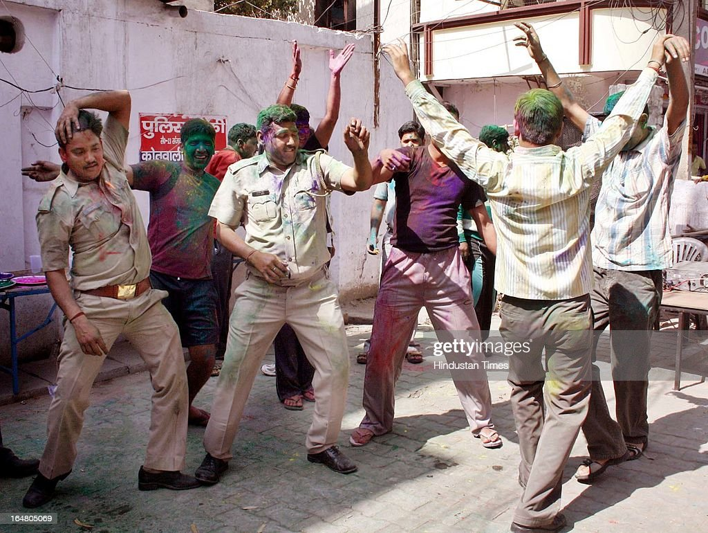 Policemen playing with colors and dancing during Holi celebrations on March 28, 2013 in Ghaziabad, India. Policemen play Holi a day after actual festival as they are on duty to prevent fights and accidents that are common on Holi day. Holi, festival of color is Hindu religious festival also called Basantotsav or spring festival as it mark the arrival of spring. People gather together to play colors, sing and dance to traditional tunes and eat sweets specially Gujiyas.