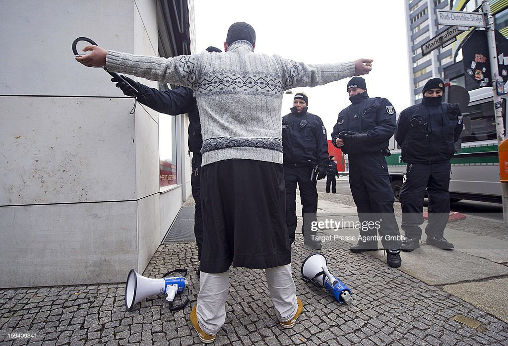 Policemen search a Salafite spokesman with a metal detector as Salafites hold benefit rally for Syrian Muslims on January 13, 2013 in Berlin. Two dozen members of 'Pro Deutschland' waited in the centre of Berlin for Salafites, who originally planned to hold a public gathering to raise money for Muslims in Syria, which included prominent speakers such as radical Islamic preacher Pierre Vogel. They then moved the event to a private gathering in Neukoelln district. Salafites are an ultra-conservative group of Muslim sunnis with hundreds of members in Berlin and the area around Bonn and cologne. German authorities are keeping a close eye on the group, espacially since clashes that broke out last year in which Salafite demonstrators attacked police and right-wing counter-demonstrators. on January 13, 2013 in Berlin, Germany.