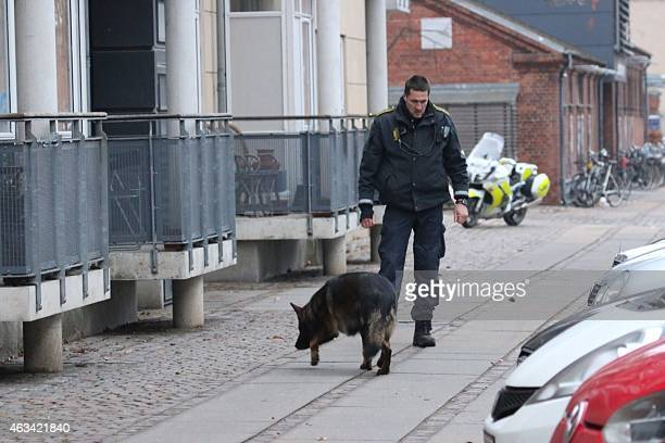 Policemen secure the area around a building in Copenhagen Denmark where shots were fired on February 14 2015 outside the venue of a debate held on...
