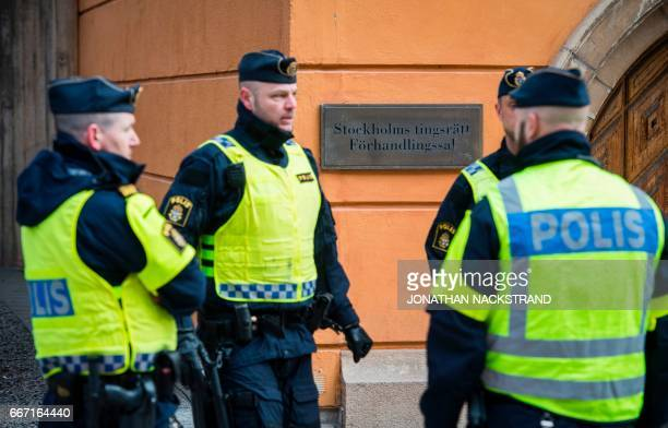 Policemen secure the entrance to the Stockholm District Court where Uzbek national Rakhmat Akilov prime suspect in the Stockholm truck attack...