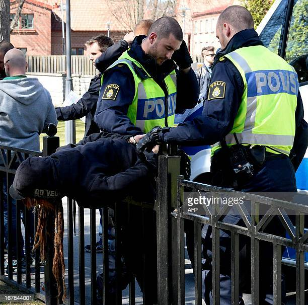 Policemen seize an activist during a Labour day demonstration organized by the rightwing 'Svenskarnas Parti' on May 1 2013 in Jonkoping Sweden AFP...