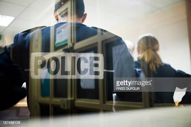 Policemen speak in their office in the Gare du Nord police station in Paris on November 29 2012 AFP PHOTO / FRED DUFOUR