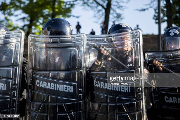 Policemen stand alert during the protest Hundreds of protesters are met in Lucca to show their disapproval for the G7 meeting the meeting of...