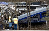 TOPSHOT Policemen stand at the site of a train accident near Bad Aibling southern Germany on February 10 2016 Two Meridian commuter trains operated...