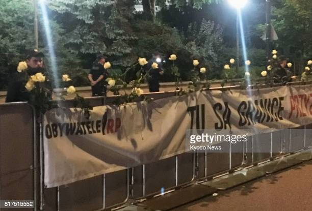 Policemen stand behind a barricade outside Poland's lower house of parliament in Warsaw on July 17 2017 The ruling Law and Justice party's planned...