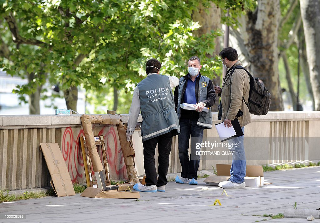 Policemen stand by painting frames outside the Paris' Musee d'Art Moderne (Paris modern art museum) where five works including paintings by modern masters Henri Matisse and Pablo Picasso have been stolen on May 20, 2010. The canvases, worth a total of 500 million euros (635 million dollars), were discovered missing from the city-run Musee d'Art Moderne when it opened its doors, the sources said.
