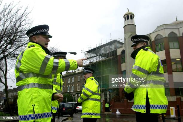 Policemen stand by the cordon in front of Finsbury Park Mosque in north London where police had conducted a raid in the early hours of 20th january...