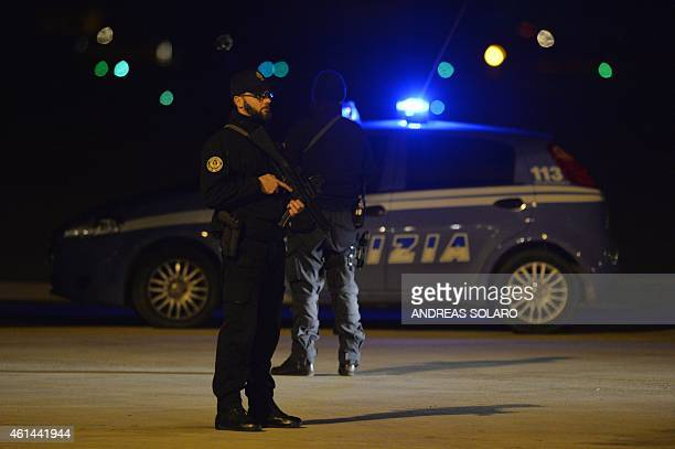 Policemen stand guard as they wait for the arrival of Pope Francis before his departure to Sri Lanka on January 12 2015 at Fiumicino airport near...