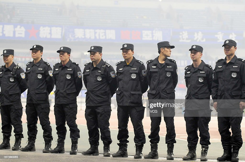 Policemen stand guard during the AFC Champions League match between Jiangsu Sainty and FC Seoul at Nanjing Olympic Sports Center Stadium on April 24, 2013 in Nanjing, China.