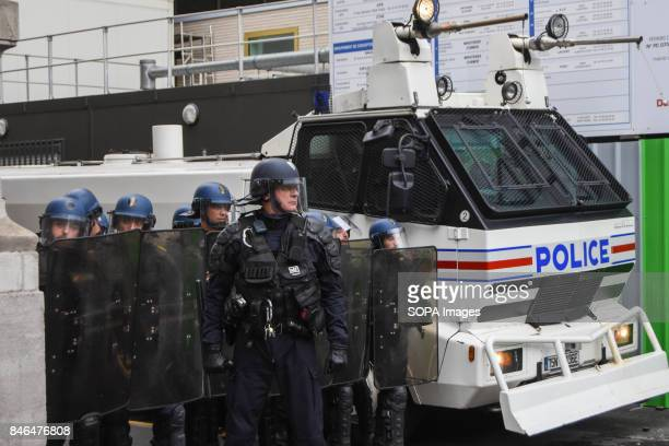 Policemen stand guard during the nationwide strike called by various French unions against proposed labour law reforms by the newly elected President...