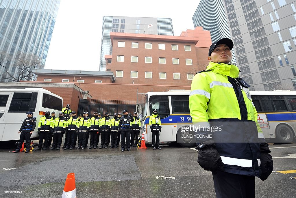Policemen stand guard in front of the Japanese embassy in Seoul on February 22, 2013 as South Korean protestors hold a rally denouncing Japan's claims to the tiny chain of Seoul-controlled rocky islands, known as Dokdo in Korea and Takeshima in Japan. South Korea bashed Japan on February 22 for holding an annual rally to renew its claim to a set of tiny islands controlled by South Korea, which has been at the centre of a long-standing territorial feud.
