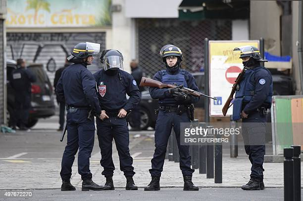 Policemen stand guard in the northern Paris suburb of SaintDenis city center on November 18 after French Police special forces raided an appartment...