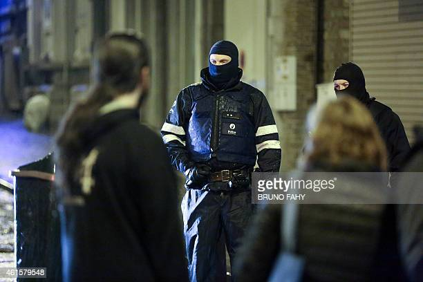 Policemen stand guard in Verviers eastern Belgium on January 15 after two men were reportedly killed during an antiterrorist operation Belgian police...
