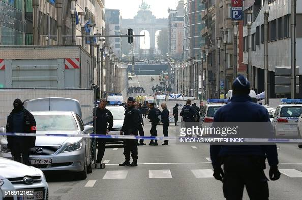 Policemen stand guard near a security perimeter set in the Rue de la Loi near the Maalbeek Maelbeek subway station in Brussels on March 22 after an...