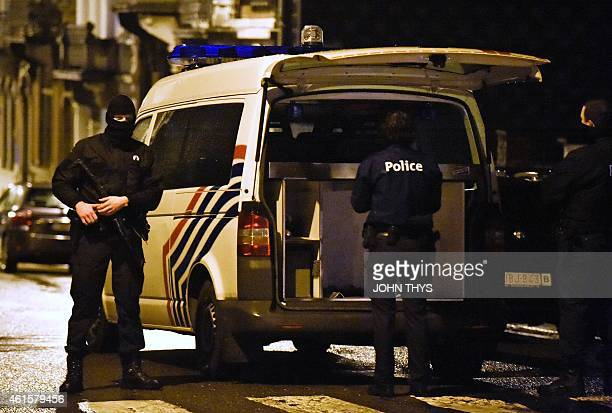 Policemen stand guard on Colline street in Verviers eastern Belgium on January 15 after two men were reportedly killed during an antiterrorist...