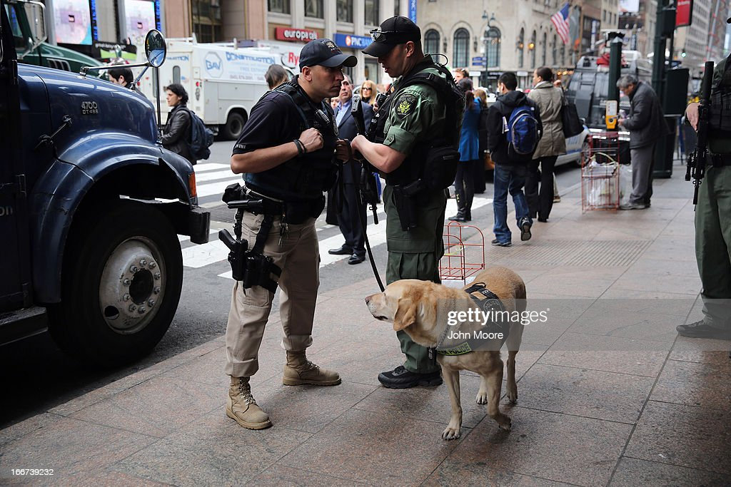 Policemen stand guard outside of Penn Station on April 16, 2013 in New York City. Police were out in force throughout New York, a day after explosions near the finish line of the Boston Marathon killed 3 people and wounded more than 170 others.