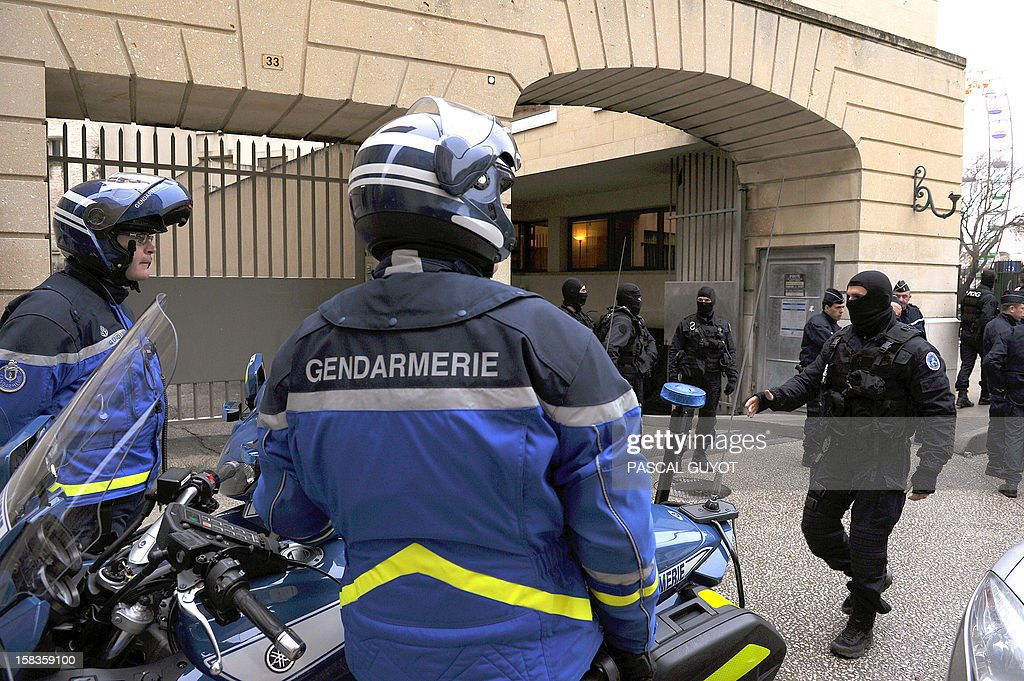 Policemen stand guard outside the Nimes courthouse before the arrival for a hearing of Kamel Bousselat, the presumed abductor of Chloe, a 15-year-old girl who was found alive in Germany after being reported missing for a week, on December 14, 2012 in Nimes, southern France.