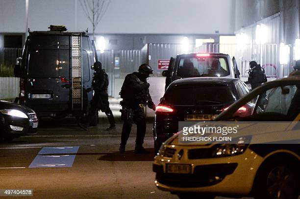 Policemen stand in front of a building on November 16 2015 in Strasbourg eastern France during investigations following the attacks in Paris claimed...