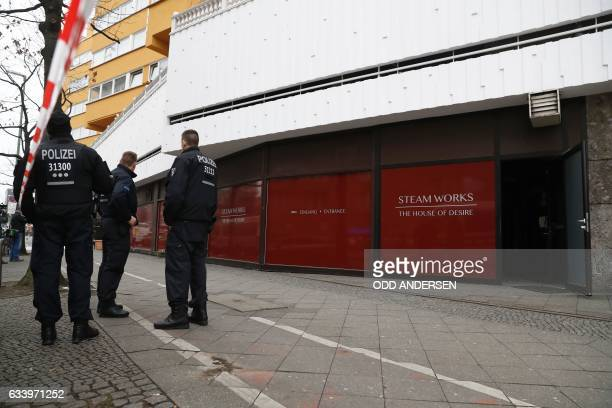 Policemen stand in front of a sauna club in Berlin on February 6 where three men died in a fire the night before / AFP / Odd ANDERSEN