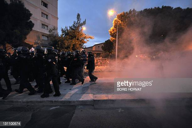 Policemen stand in front of protesters on November 1 2011 during a demonstration in the French city of Nice two days ahead of the G20 summit to be...