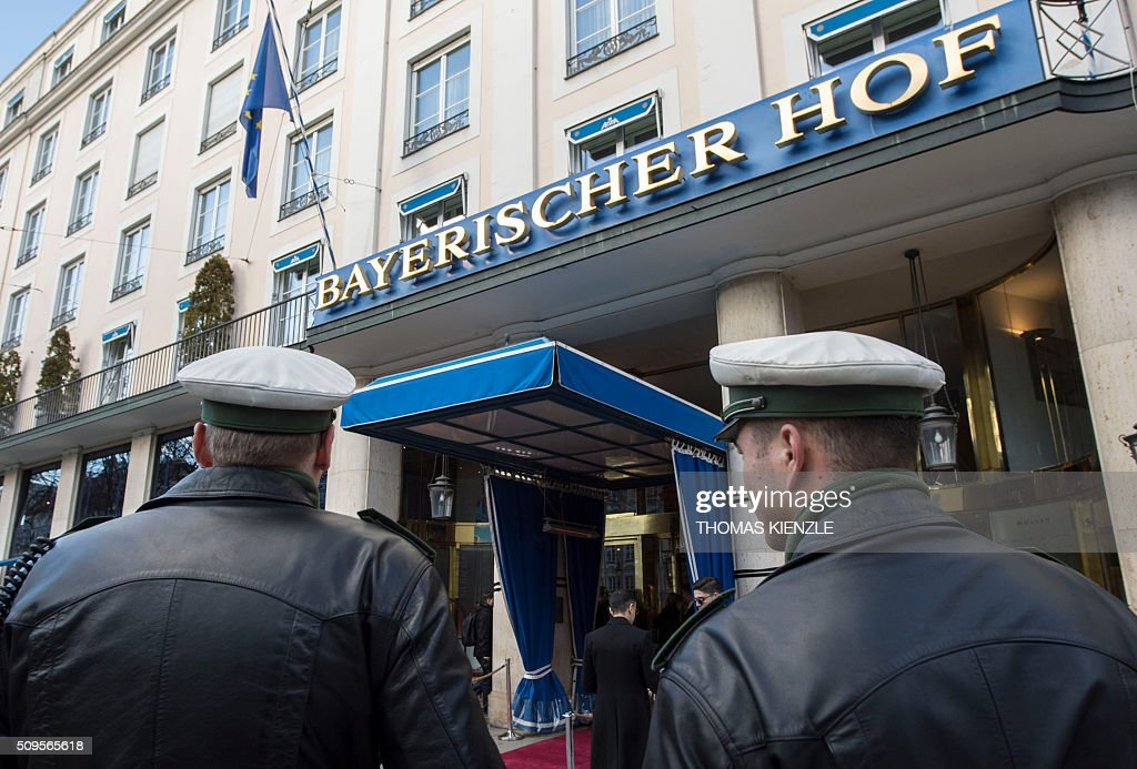 Policemen stand in front of the Bayerischer Hof hotel, the location for the 52nd Munich Security Conference (MSC), in Munich, southern Germany, on February 11, 2016. The Munich Security Conference takes place from February 12 und until February 14, 2016. / AFP / THOMAS KIENZLE