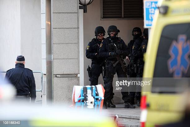 Policemen stand in front of the entrance of a building in Storgatan in central Malmo on October 11 2010 A man with a large knife grabbed a twoyearold...
