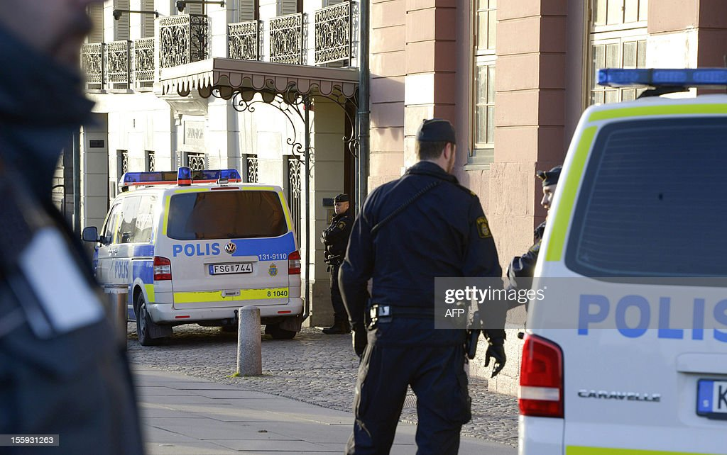 Policemen stand in front of the Swedish Prime Minister Fredrik Reinfeldt´s residence Sagerska Palace on November 9, 2012 in Stockholm.According to the police a security guard at has shot himself to death in an accident. AFP PHOTO /SCANPIX SWEDEN- Bertil Enevag Ericson SWEDEN OUT