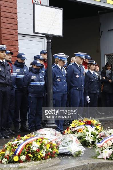 Policemen stand next to a plaque in memory of the late policewoman Clarissa JeanPhilippe during a tribute ceremony two years after her killing in...