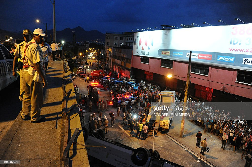 Policemen stand on a bridge with a height of 15 meters from where a bus fell in Rio de Janeiro, Brazil on April 2, 2013. The accident left 7 people dead and 11 injured.