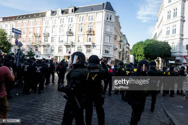 Policemen stand on a crossroad in the Schanzenviertel in Hamburg on July 8 2017 Aer the police had cleared a lot of peaceful people in front of the...