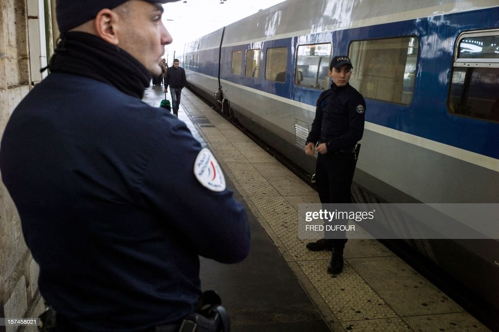 Policemen stand on a platform as they patrol the Gare du Nord (North railway station) in Paris on November 29, 2012 .