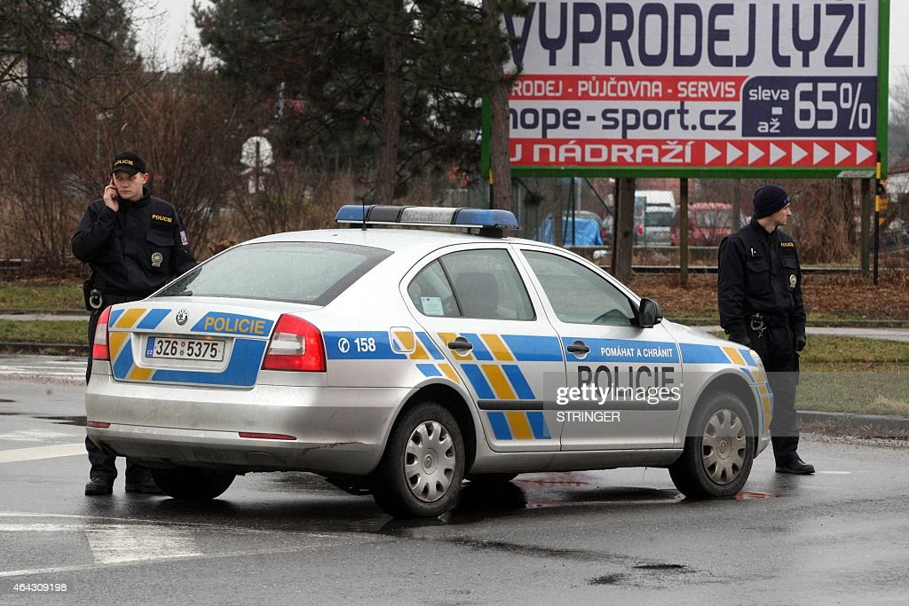 Policemen stand on a street of Uhersky Brod Czech Republic on February 24 2015 after an apparently unstable armed man bursted into a restaurant in...