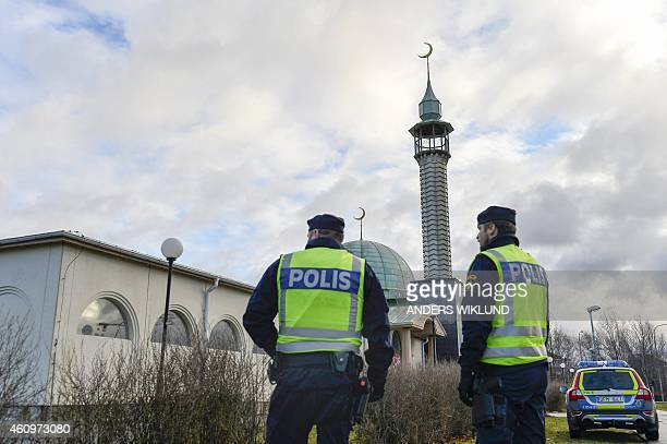 Policemen stand outside a mosque in Uppsala on January 2 2015 The mosque suffered a firebomb attack on January 1 one of three arson attacks targeting...