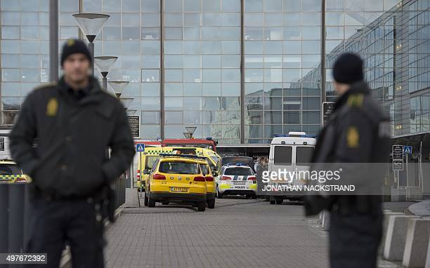 Policemen stand outside terminal 3 at Kastrup airport in Copenhagen on November 18 2015 Danish police evacuated one of two terminals at Copenhagen's...