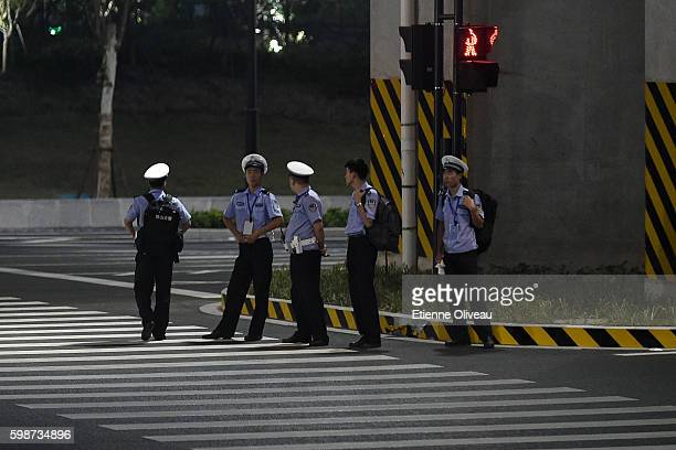 Policemen standing at a street corner during the G20 Hangzhou Summit on September 2 2016 in Hangzhou China