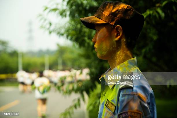 A policemen stands guard during the Colour Run at the Beijing International Garden Expo park on June 17 2017 in Beijing China
