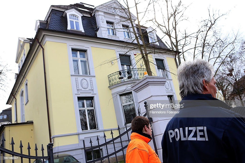 Policemen stands outside the headquarters of the S&K investment group the day after police raided the company's offices on February 20, 2013 in Frankfurt, Germany. Police made six arrests across Germany and state prosecutors are charging that the company has swindled investors out of investments totaling over one hundred million Euros. At least one of the company's founders, Jonas Koeller and Stephan Schaefer, was among those arrested yesterday.