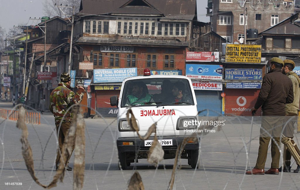 Policemen stop a Ambulance vehicle on the 3rd day of curfew on February 11, 2013 in Srinagar, India. Kashmir Valley remained under curfew for the third day today even as mobile and Internet services remained suspended following hanging of Parliament attack convict Mohammad Afzal Guru.