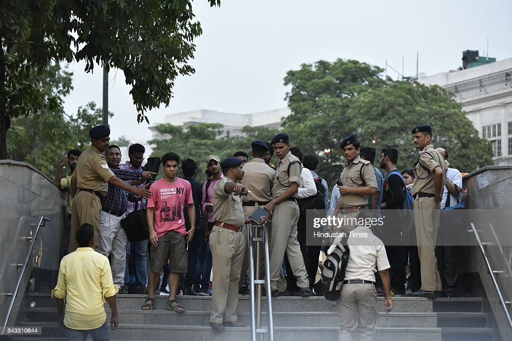 Policemen stop people from entering the Rajiv Chowk metro station to prevent overcrowding as the as metro services halts due to a technical glitch on June 27, 2016 in New Delhi, India. Due to the breakdown of an overhead wire between Subhash Nagar and Tilak Nagar Metro stations, operations on the entire 51-km-long route remained affected for two-and-half hours.
