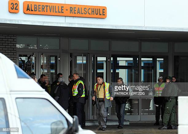 Policemen surround the entrance of the Albertville secondary school in Winnenden southern Germany on March 11 2009 A teenager in black combat gear...