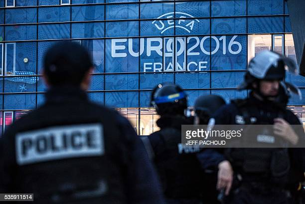 Policemen take part in a mock suicide attack exercise as part of security measures for the upcoming Euro 2016 football championship at the Parc...
