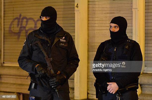Policemen take security measures in Colline street in Verviers eastern Belgium on January 15 after two men were reportedly killed and a third...