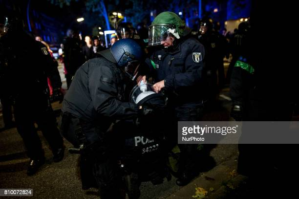 Policemen treat a colleague after she gets in contact with tear gas in Hamburg Germany on July 6 2017 The police stopped the leftradical...