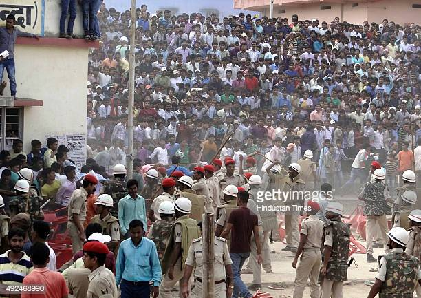Policemen use lathcharge to quell crowd after they started pelting stones over late arrival of Bollywood actor Ajay Devgn at an election rally for...