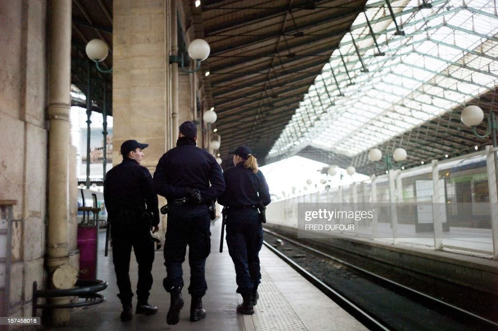 Policemen walk on a platform as they patrol the Gare du Nord (North railway station) in Paris on November 29, 2012 . AFP PHOTO / FRED DUFOUR