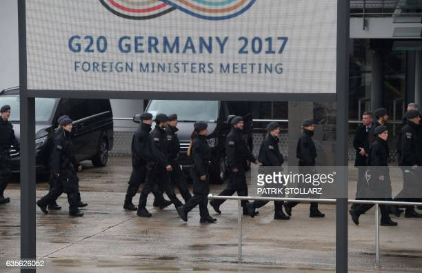Policemen walk past the World Conference Center in Bonn western Germany on February 16 the venue of a G20 Foreign Ministers Meeting that will take...
