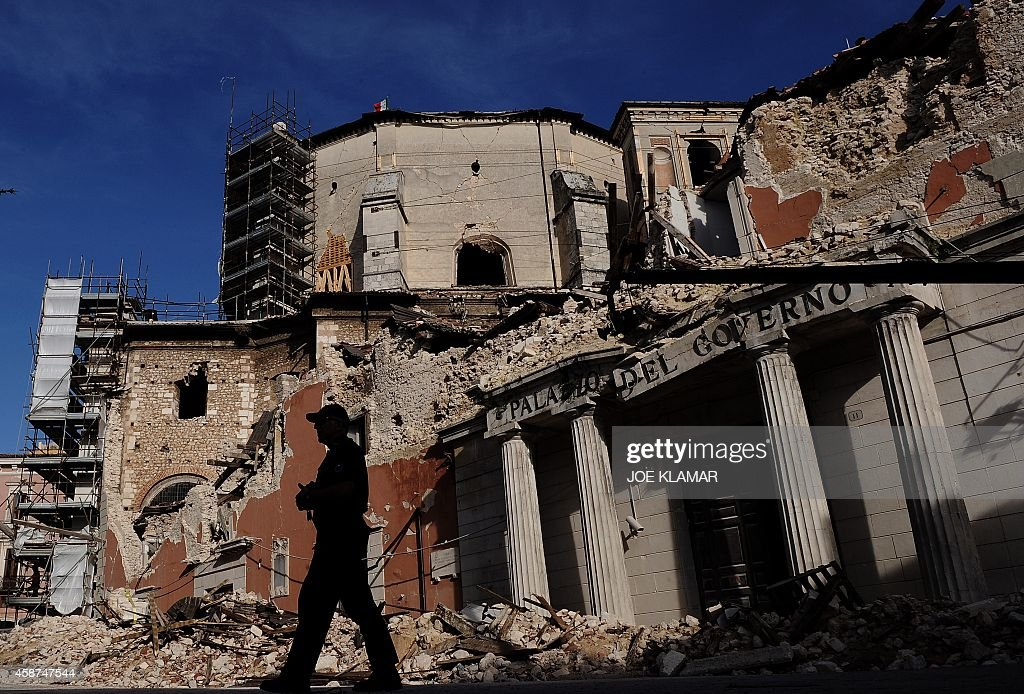 A policemen walks by the Palazo de Governo in downtown L'Aquila prior to the visit by Italian Prime Minister Silvio Berlusconi and US President...