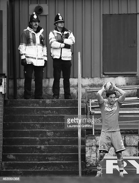 Policemen watch the action during the FA Cup Fifth Round match between Bradford City and Sunderland at Coral Windows Stadium Valley Parade on...