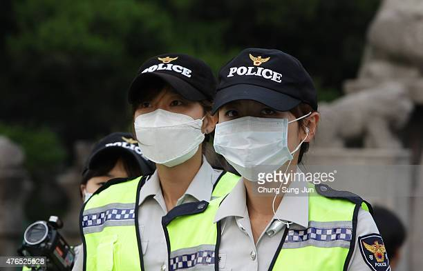 Policemen wear masks as a precaution to protect them against the MERS virus on June 10 2015 in Seoul South Korea South Korea has reported 9 deaths...